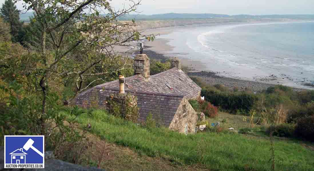 Image showing a rural coastal cottage in the UK